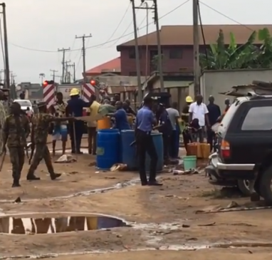 Residents of Ijegun community in Lagos filmed scooping fuel from broken pipeline