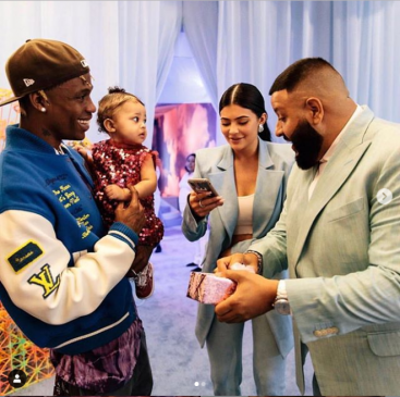 DJ Khaled gifts Travis Scott and Kylie Jenner's daughter Stormi a Chanel purse at her 1st birthday party (Photos/Video)