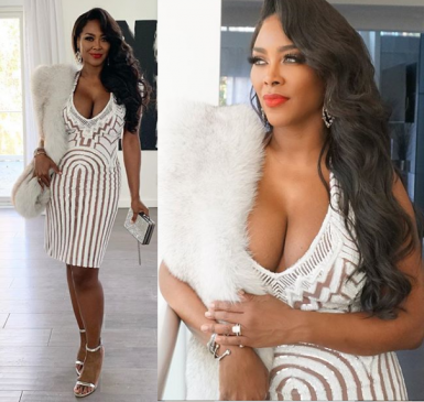 Kenya Moore flaunts plenty of cleavage in sexy white lace dress (Photos)
